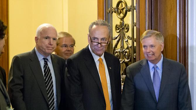 "Members of the bipartisan ""Gang of Eight"" who crafted the immigration reform bill, Sen. Chuck Schumer, D-N.Y., center, flanked by Sen. John McCain, R-Ariz., left, and Sen. Lindsey Graham, R-S.C., leave the floor after final passage in the Senate, at the Capitol in Washington, Thursday, June 27, 2013. Sen. Robert Menendez, D-N.J., follows at rear. In remarks to reporters, Sen. Lindsey Graham, a conservative Republican, praised the leadership of Democrat Chuck Schumer, saying ""Senator Schumer's a worthy successor to Ted Kennedy."" (AP Photo/J. Scott Applewhite)"