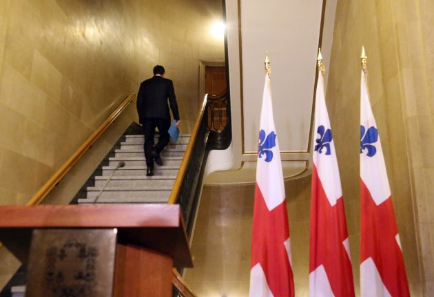 Montreal mayor Michael Applebaum walks away after announcing his resignation during a news conference in Montreal