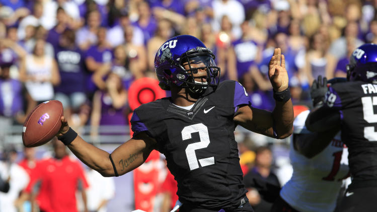 TCU quarterback Trevone Boykin (2) passes during the first half of an NCAA college football game against Texas Tech, Saturday, Oct. 20, 2012, in Fort Worth, Texas. (AP Photo/LM Otero)