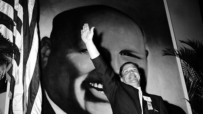 FILE - In this Sept. 30, 1957, file photo Jimmy Hoffa, Teamsters vice president and leading candidate to succeed Dave Beck as the IBT's new president, waves to delegates at the opening of the Teamsters Union convention at Miami Beach, Fla. Hoffa's mysterious disappearance, assumed death and myriad searches for his body have been the stuff of urban legends for more than three decades and continue with the most recent report that the former Teamsters chief's remains are buried beneath a concrete driveway just north of Detroit.  (AP Photo/File)