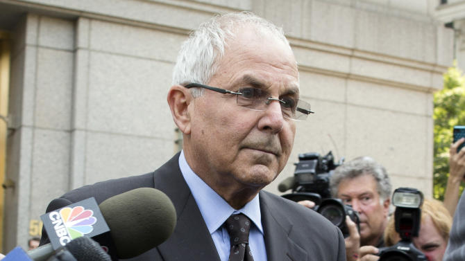 FILE - In this June 29, 2012 file photo, Peter Madoff leaves Federal Court in New York after pleading guilty to criminal charges. The prison-bound brother of Wall Street swindler Bernard Madoff has attended his granddaughter's bat mitzvah in New York. Peter Madoff was sentenced in December to 10 years in prison for his role in the massive Ponzi scheme. The judge delayed his lockup date so he could attend the Jewish ceremony. The 67-year-old pleaded guilty in June to charges that he created false documents while he was chief compliance officer at his brother's firm. (AP Photo/John Minchillo, File)
