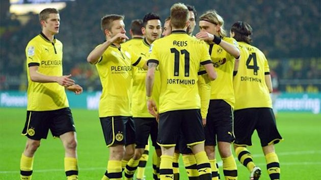 Dortmund celebrate with Marco Reus after one of his three goals in the 3-0 win over Eintrach Frankfurt