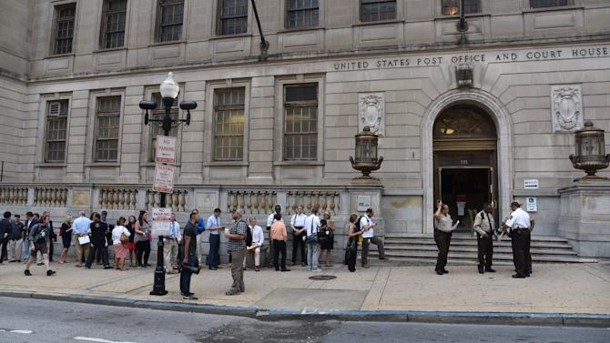 """Members of the media stand in line to enter the Baltimore Circuit Court, as the first court hearing was set to begin in the case of six police officers criminally charged in the death of Freddie Gray, on Wednesday, Sept. 2, 2015 in Baltimore.  Six police officers face charges that range from second-degree assault, a misdemeanor, to second-degree """"depraved-heart"""" murder.   (Kim Hairston/The Baltimore Sun via AP)  WASHINGTON EXAMINER OUT; MANDATORY CREDIT"""