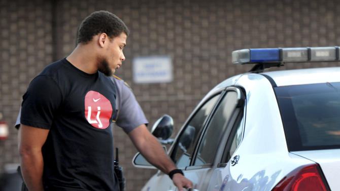 In this photo provided by The Daily Reveille, former LSU star cornerback Tyrann Mathieu is placed in a police car at Baton Rouge Police Department Second District Police Station bound for East Baton Rouge Parish prison after he and former LSU  teammates Jordan Jefferson, Derrick Bryant and Karnell Hatcher were found in The Venue at Northgate, an apartment complex, with 18 grams of marijuana in Baton Rouge, Thursday, Oct. 25, 2012 (AP Photo/The Daily Reveille, Catherine Threlkeld)
