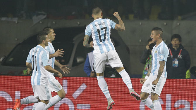 Argentina's Marcos Rojo, right, celebrates after scoring against Paraguay with teammates Argentina's Nicolas Otamendi, center, and Argentina's Sergio Aguero, left, during a Copa America semifinal soccer match at the Ester Roa Rebolledo Stadium in Concepcion, Chile, Tuesday, June 30, 2015. (AP Photo/Ricardo Mazalan)