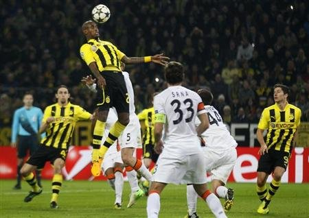 Borussia Dortmund's Felipe Santana (in air) scores a goal against Shakhtar Donetsk during their Champions League soccer match in Dortmund March 5, 2013. REUTERS/Wolfgang Rattay