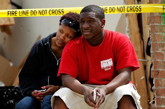 Cambrie Thornton (L) and Royal Thornton (R) sit outside their destroyed home after a tornado on April 4, 2012 in Forney, Texas. Multiple tornadoes touched down yesterday across the Dallas/Fort Worth area causing extensive damage.  (Photo by Tom Pennington/Getty Images)