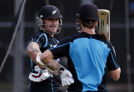 New Zealand cricket team player McCullum talks with teammate Williamson during a training session at the University Oval in Dunedin