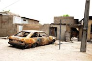 <p>A house and car are ravaged by a bomb explosion by the Islamist group Boko Haram in Maiduguri, northeastern Nigeria, in May 2012. More than 1,000 Nigerians have fled to neighbouring Niger after six people were killed in an attack on their village blamed on Islamist group Boko Haram, the United Nations said Thursday.</p>