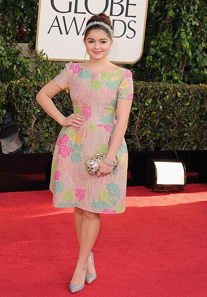 Ariel Winter: The 'Modern Family' star who has been involved in her own family drama lately, is nothing like her dorky character on the show in this elegant floral teacup gown complete with sparkly silver pumps and a gold quilted clutch. But it's the beautiful hair piece that really stands out. (Photo by Steve Granitz/WireImage)