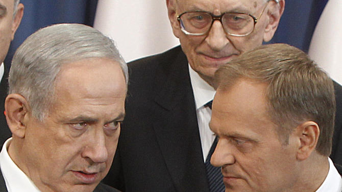 Israeli Prime Minister Benjamin Netanyahu, left, and his Polish counterpart Donald Tusk  talk  in Warsaw, Poland, Wednesday, June 12, 2013. Netanyahu came to Poland for a two day visit for talks with Tusk and to attend the opening of a Holocaust exhibition in the former German Nazi Death Camp Auschwitz Birkenau. (AP Photo/Czarek Sokolowski)