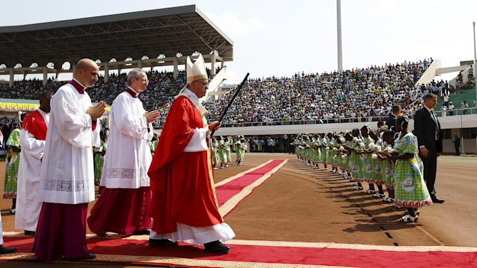 Pope Francis arrives to lead a mass at the Bangui stadium