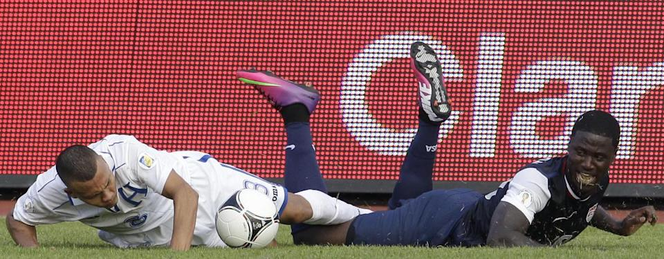 U.S. Eddie Johnson, right, and Honduras' Arnold Peralta, left, struggle for the ball during a 2014 World Cup qualifying soccer match in San Pedro Sula, Honduras, Wednesday Feb. 6, 2013. Honduras won 2-1. (AP Photo/Moises Castillo)