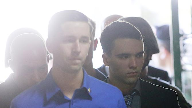 U.S. Marine Lance Corporal Joseph Scott Pemberton is escorted into a court in Olongapo city, north of Manila