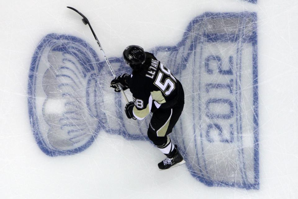 Pittsburgh Penguins' Kris Letang (58) warms up before Game 1 of the opening-round of NHL hockey playoff action against the Philadelphia Flyers, Wednesday, April 11, 2012, in Pittsburgh. (AP Photo/Gene J. Puskar)