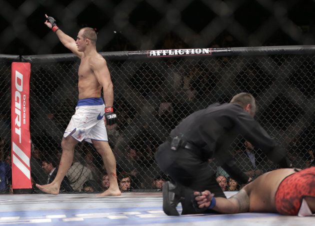 Junior Dos Santos reacts after knocking out Mark Hunt in the third round of a UFC 160 mixed martial arts heavyweight bout,  Saturday, May 25, 2013, in Las Vegas. (AP Photo/Julie Jacobson)