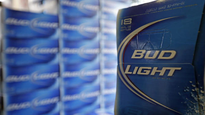 FILE - In this Monday, Jan. 28, 2013, file photo, Bud Light beer is shown in the aisles of Elite Beverages in Indianapolis. Beer lovers across the country have filed $5 million class-action lawsuits accusing Anheuser-Busch of watering down its Budweiser, Michelob and other brands.  (AP Photo/Michael Conroy, File)
