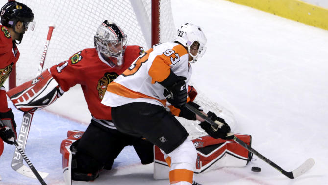 Chicago Blackhawks goalie Antti Raanta (31) makes a save on a shot my Philadelphia Flyers right wing Jakub Voracek, during the third period of an NHL hockey game Tuesday, Oct. 21, 2014, in Chicago. The Blackhawks won 4-0. (AP Photo/Charles Rex Arbogast)