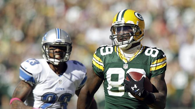 Green Bay Packers' James Jones breaks away from Detroit Lions' Chris Houston (23) for an 83-yard touchdown catch during the second half of an NFL football game Sunday, Oct. 6, 2013, in Green Bay, Wis