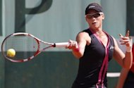 Australia's Samantha Stosur during the French Open women's singles first round match against American Irina Falconi. Stosur reached the third round with a 6-1, 6-4 win. Australian sixth seed Stosur saw off Falconi 6-1, 6-4