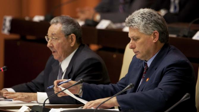 Cuba's newly named Vice President Miguel Diaz-Canel, right, looks at a sheet of paper as Cuba's President Raul Castro speaks during the closing session at the National Assembly in Havana, Cuba, Sunday, Feb. 24, 2012. Castro tapped rising star Diaz-Canel, 52, as the country's vice-president Sunday. Diaz-Canel has risen higher than any other Cuban official who didn't directly participate in the 1959 Cuban revolution.  (AP Photo/Franklin Reyes)