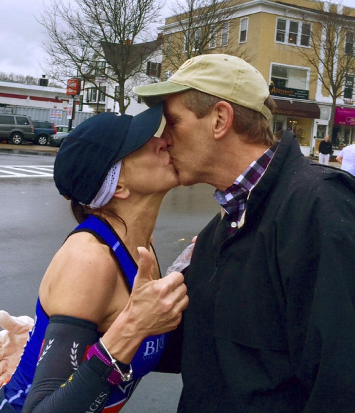 Woman seeking man she kissed at marathon hears from his wife