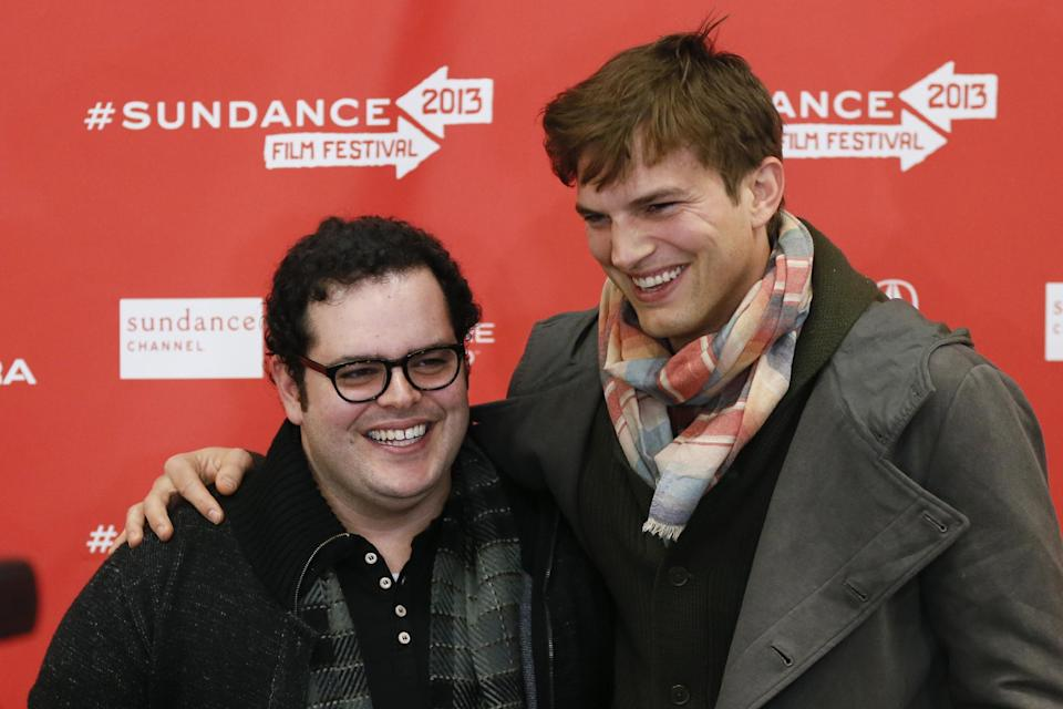 "Actors Ashton Kutcher, right, who portrays Steve Jobs, and Josh Gad, who portrays Steve Wozniak, pose together at the premiere of ""jOBS"" during the 2013 Sundance Film Festival on Friday, Jan. 25, 2013 in Park City, Utah. (Photo by Danny Moloshok/Invision/AP)"