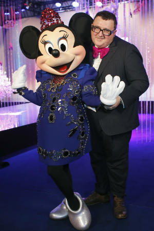 Israeli fashion designer Alber Elbaz poses with Minnie wearing a dress by Lanvin fashion house and designed by Alber Elbaz, at the Eurodisney Parc, in Marne la Vallee, east of Paris, Saturday, March 23, 2013. (AP Photo/Thibault Camus)