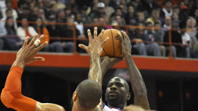 Philadelphia 76ers' Jason Richardson shoots over New York Knicks' Tyson Chandler (6) during the first quarter of an NBA preseason basketball game, Monday, Oct. 22, 2012, in Syracuse, N.Y. (AP Photo/Kevin Rivoli)