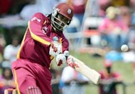 West Indies batsman Chris Gayle hits a boundary during the second Twenty20 between West Indies and New Zealand at the Central Broward Regional Park Stadium in Lauderhill, Florida, on July 1. Gayle smashed a third successive half-century as West Indies cruised to a nine-wicket win over New Zealand in Thursday's opening one-day international in Jamaica