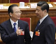 File photo shows Chinese Premier Wen Jiabao (L) talking to Vice President Xi Jinping. The Communist Party&#39;s Central Committee convened behind closed doors, state media said, with 500 senior members brought together ahead of a congress which will open on November 8 to usher in leaders for the next decade