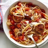 A twist on the classic spaghetti and meatballs, you'll love this herbed chicken variation. Top with Parmesan cheese and enjoy!