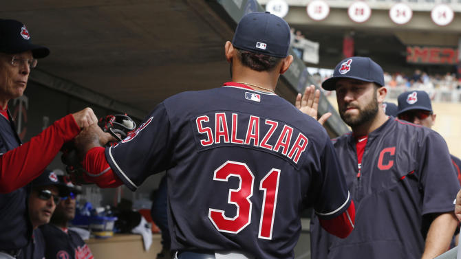 Cleveland Indians pitcher Danny Salazar, center, is congratulated after leaving in the seventh inning of a baseball game against the Minnesota Twins, Saturday, April 18, 2015, in Minneapolis. The Indians won 4-2.  Salazar picked up the win, his first. (AP Photo/Jim Mone)