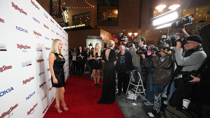 Kendra Wilkinson arrives at the Rolling Stone American Music Awards After Party, on Sunday, Nov. 18, 2012 in Los Angeles. (Photo by Casey Rodgers/Invision for Nokia/AP Images) **Please include any additional event details in the second sentence of the caption.