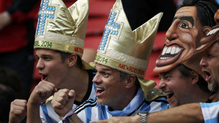 Fans of Argentina gesture as they attend the 2014 World Cup Group F soccer match against Nigeria at the Beira Rio stadium in Porto Alegre