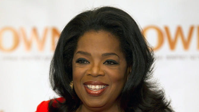 """FILE - This April 16, 2012 file photo shows Oprah Winfrey in Toronto. Winfrey and Arianna Huffington launched """"HuffPost OWN,"""" a new section on the Huffington Post website on Thursday, Nov. 1, that will feature material from the Oprah Winfrey Network and Oprah.com. The new online destination will focus on lifestyle advice and personal inspiration. (AP Photo/The Canadian Press, Frank Gunn, file)"""