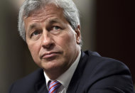 <p>               FILE- In this Wednesday, June 13, 2012, file photo, JPMorgan Chase CEO Jamie Dimon, head of the largest bank in the United States, testifies before the Senate Banking Committee on Capitol Hill in Washington. All eyes will be on JPMorgan Chase on Friday, when it becomes the first U.S. bank to report financial results for April through June. The $2 billion trading loss by the largest U.S. bank rattled the company's stock price, triggered a U.S. government investigation and hurt both its reputation and that of CEO Jamie Dimon. (AP Photo/J. Scott Applewhite, File)