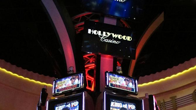 Gamblers try out the games as the new Hollywood Casino Columbus opens on Oct. 8, 2012, in Columbus, Ohio.  The $400 million Hollywood Casino Columbus is expected to draw 3 million visitors annually.   The $400 million Hollywood Casino Columbus is expected to draw 3 million visitors annually.  (AP Photo/Kantele Franko.)