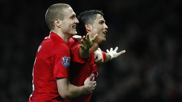 Manchester United's Cristiano Ronaldo (R) celebrates with Nemanja Vidic after scoring his second goal during their English Premier League soccer match against Stoke City in Manchester, northern England, November 15, 2008. (Reuters)
