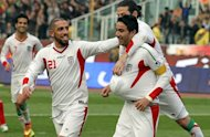Javad Nekounam (right) celebrates after scoring for Iran against Lebanon in Tehran today. Nekounam starred with a hat-trick as three-time champions Iran kick-started their 2015 Asian Cup qualifying campaign with a crushing 5-0 victory over Lebanon on Wednesday