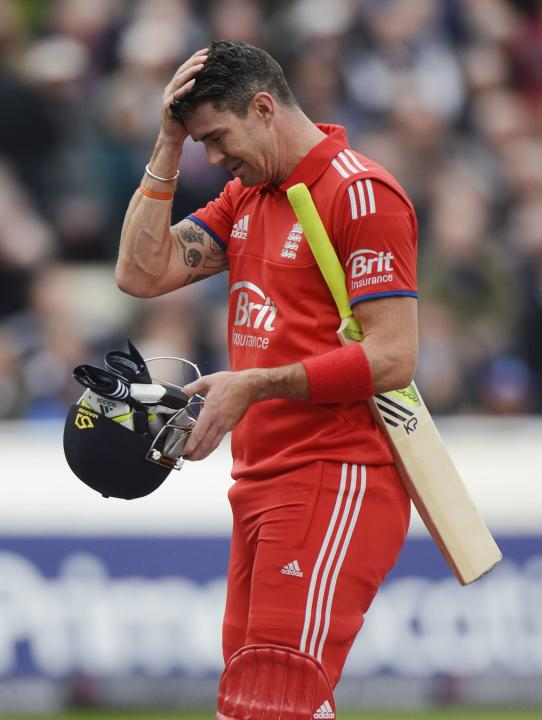 England's Pietersen leaves the field after being caught during the third one-day international against Australia in Birmingham