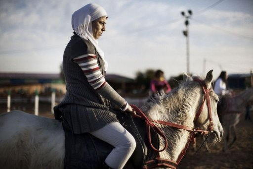 Ola Abu Safia, 18, rides a horse at the Al-Faisal riding centre in Gaza City on January 10, 2012. Horse riding has become a popular hobby in the Gaza Strip but local Palestinians face constant hurdles -- from a conservative society to Israel&#39;s blockade on the territory -- to practise the sport on their home turf