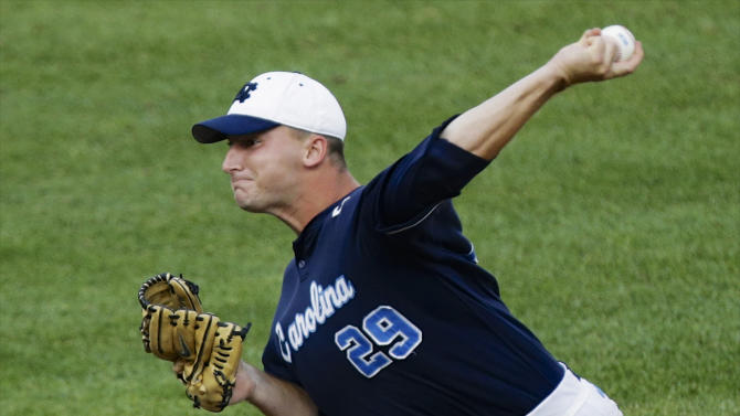 North Carolina starting pitcher Hobbs Johnson works against North Carolina State in the first inning of an NCAA College World Series elimination baseball game in Omaha, Neb., Thursday, June 20, 2013. (AP Photo/Nati Harnik)