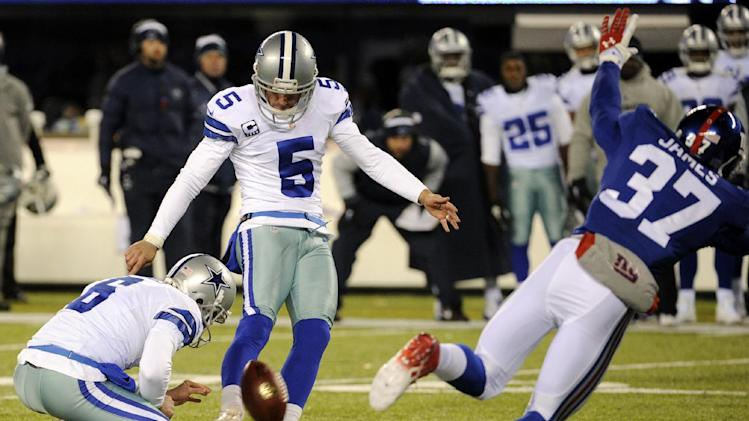 Dallas Cowboys kicker Dan Bailey (5), with Chris Jones holding, kicks a game-winning field goal against the New York Giants during the second half of an NFL football game, Sunday, Nov. 24, 2013, in East Rutherford, N.J. The Cowboys won 24-21. (AP Photo/Bill Kostroun)
