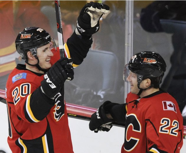 Calgary Flames' Glencross celebrates first goal against Nashville Predators with Stempniak during NHL hockey game in Calgary