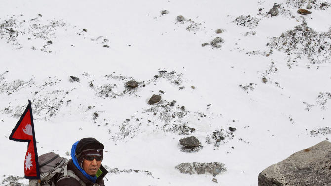 In this photo taken on Feb. 13, 2012 and released by The Great Himalayan Trail, veteran climber Apa Sherpa climbs the Himalayan mountains on the way to the Tshorolpa Glacier Lake, Nepal. The 51-year-old Apa is on a 120-day trek across Nepal to tell villagers about the danger of more devastating flash floods as glacial melt caused by climate change fills high-altitude lakes to the bursting point. (AP Photo/The Great Himalayan Trail)  EDITORIAL USE ONLY