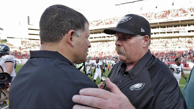 Philadelphia Eagles head coach Andy Reid, right, consols Tampa Bay Buccaneers head coach Greg Schiano after the Eagles defeated the Buccaneers 23-21 during an NFL football game Sunday, Dec. 9, 2012, in Tampa, Fla. (AP Photo/Chris O'Meara)