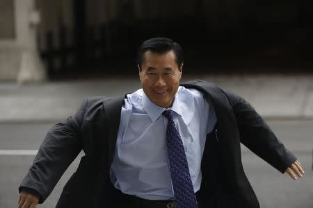 Suspended California State Senator Leland Yee arrives at the Phillip Burton Federal Building for his arraignment hearing in San Francisco, California