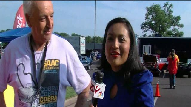Father and daughter celebrate at car show