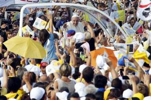 Pope Francis waves as he arrives to lead a mass outside the Shrine of Our Lady of Bonaria in Cagliari